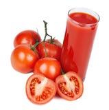 Tomato juice and ripe tomatoes. Glass of tomato juice and ripe tomatoes isolated on white Stock Photography