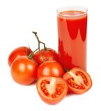 Tomato juice and ripe tomatoes Stock Image