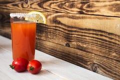 Tomato juice with salt lemon and tomatos Stock Photo