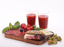 Tomato juice with sandwich Stock Images