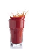 Tomato juice splash in a glass Royalty Free Stock Image