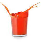 Tomato juice with splash. In small glass isolated on white Royalty Free Stock Photography