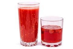 Tomato juice and strawberry compote Stock Photography