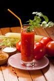 Tomato juice on table. Tomato juice with celery on table with black background Stock Photography