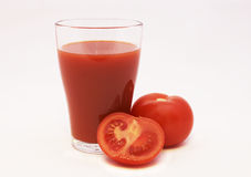 Tomato juice and tomato. Es isolated on a white background Royalty Free Stock Photography