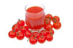 Tomato juice and tomatoes Stock Images