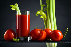 Tomato juice with tomatoes and celery sticks Stock Image