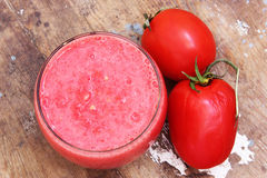 Tomato juice with tomatoes Royalty Free Stock Image