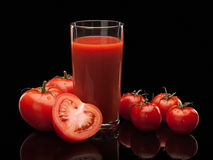 Tomato juice and tomatoes Royalty Free Stock Photography