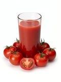 Tomato juice and tomatoes Stock Photos