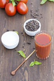 Tomato juice, tomatos, herbs and spices. On wooden table royalty free stock photo