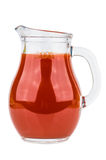 Tomato juice in transparent glass pitcher isolated on white Stock Photos