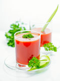 Tomato juice in transparent glasses with parsley and cucumber, c Stock Photo