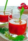 Tomato juice in two glasses. stock photography