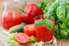 Tomato juice. Vegetable juice made of tomatoes, bell peppers, celery, Basil. And spices Royalty Free Stock Photography
