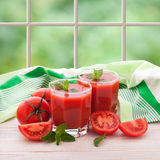 Tomato juice with vegetables on white wooden table Royalty Free Stock Images