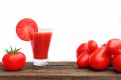 Tomato Juice on wooden board Royalty Free Stock Image