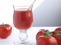 Tomato juice X. A glass of tomato juice and fresh tomato Royalty Free Stock Photo