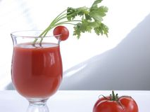 Tomato juice XII. A glass of tomato juice and fresh tomato Stock Images