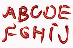 Tomato ketchup alphabet Stock Image