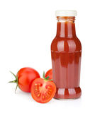 Tomato ketchup bottle and ripe tomatoes Royalty Free Stock Images