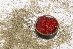 Tomato ketchup and dry rosemary. Royalty Free Stock Images