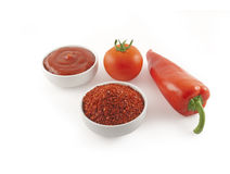 Tomato, ketchup, red pepper and ground red pepper Royalty Free Stock Images