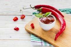 Tomato ketchup sauce salsa, hot chili and basil Stock Image