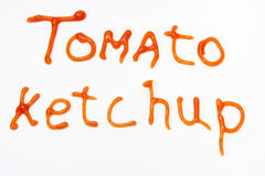 Tomato ketchup sign written with red ketchup on the white backgr Stock Image