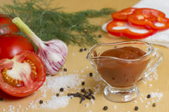 Tomato ketchup. On a table all necessary ingredients for preparation of ketchup Stock Image