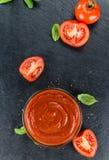 Tomato Ketchup on a vintage slate slab selective focus. Some fresh made Tomato Ketchup on a vintage slate slab selective focus; close-up shot stock images