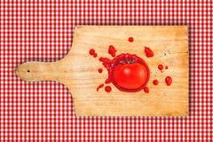 Tomato and ketchup on wooden board Royalty Free Stock Photo