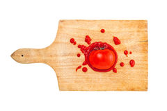 Tomato and ketchup on wooden board Stock Images