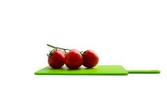 Tomato kitchen cut board isolated white background Royalty Free Stock Photos