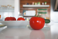 Tomato in the kitchen Stock Images