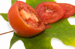 Tomato on leaf Royalty Free Stock Photos