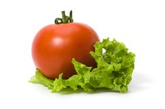 Tomato on a leaf of lettuce isolated Stock Photo