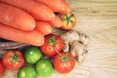 Tomato lemon ginger and carrot in basket Royalty Free Stock Photo