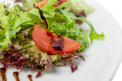 Tomato and lettuce closeup. Royalty Free Stock Images