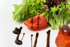 Tomato and lettuce closeup with soya sauce. Royalty Free Stock Photography
