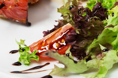 Tomato and lettuce closeup with soya sauce. Stock Image