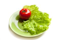 Tomato and lettuce on a dish Royalty Free Stock Photo