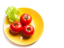 Tomato and lettuce on a dish Royalty Free Stock Image