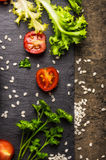 Tomato, lettuce, greens and rice, dieting food. Background, top view stock photography