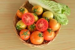Tomato lettuce vegetable basket Royalty Free Stock Photos