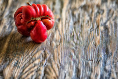 Tomato like a human head on wooden background with copy space.  Stock Photography