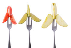 Tomato, lime and apple on a fork Stock Images
