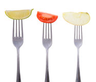Tomato, lime and apple on a fork Stock Photography