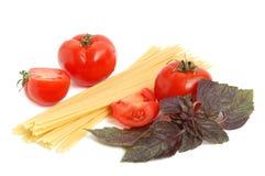 Tomato, macaroni and basil royalty free stock photo