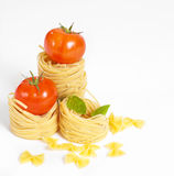 Tomato, macaroni and green basil Royalty Free Stock Photography